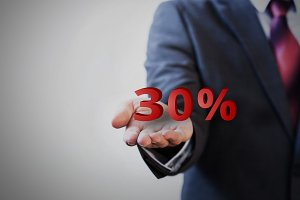 Businessman presenting 30 percent graphic on hand