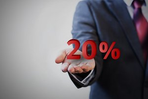 Businessman presenting 20 percent graphic on hand