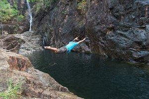 Man jumping on Waterfall