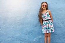 Adorable girl in beautiful dress