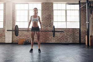 Muscular woman in a gym