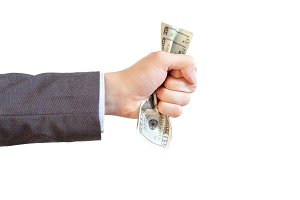Businessman grasping and giving money in white isolated background (with clipping path)