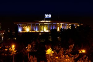 Knesset with flag Parliament of Israel at night