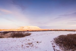 Landscape near of Kerid (or Kerith) volcanic crater lake on the touristic golden circle route in Iceland in winter