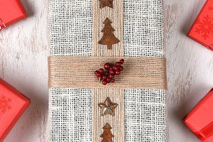 Burlap Wrapped Gift and Red Presents