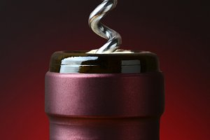 Wine Bottle and Corkscrew Closeup