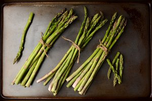 Bunches of Asparagus on Cooking Shee