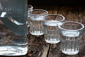 bottle of vodka and shot glasses