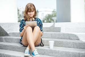 Reading on tablet.