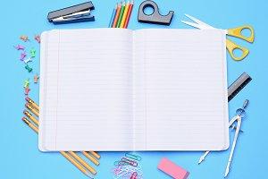 Open Notebook With School Supplies