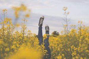 Girl upside down in a rapeseed field