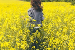 Girl running in a yellow field