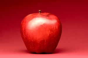 delicious apple on red