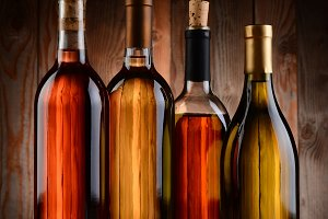 Wine Bottles Against Wood Background