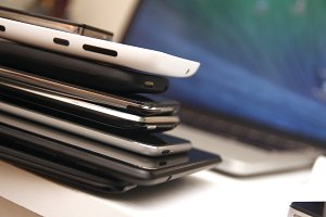 Stack of Devices on a Desk