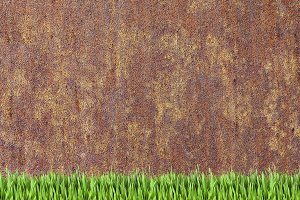 Rusy wall and grass background