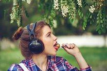 Girl with headphones and lollipop