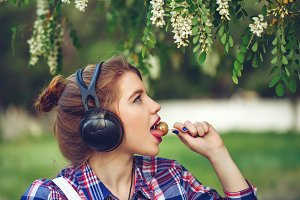Girl with headphones and lollipop
