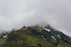 Green Hills and Mountains in Clouds