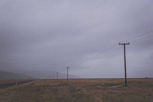 Rain Clouds over foggy Landscape