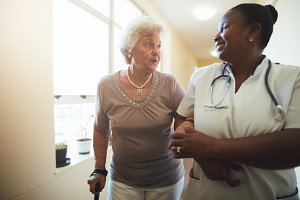 Nurse assisting senior female