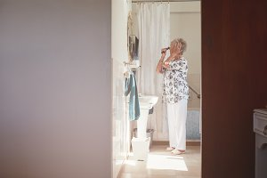 Elderly woman getting ready