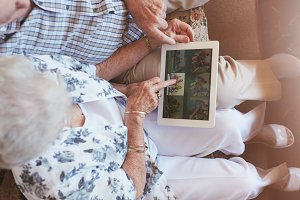 Elderly couple looking images