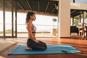 Fitness woman sitting in yoga