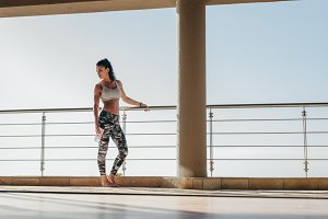 Fit woman standing in the balcony