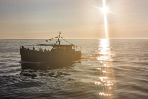 Boat returned to port during sunset