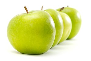 apples in row isolated on white