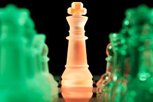 multicolored chess pieces in dark