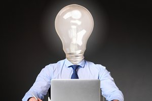 businessman with bulb instead of his head