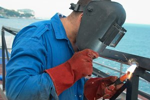 Welder at the factory working