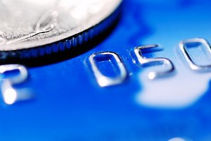 blue credit card with a coin