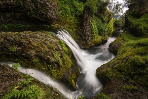 Small Waterfall in a mossy Canyon