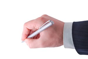 businessman holds silver pen