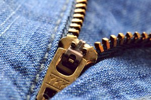 jeans zipper closeup, shallow dof