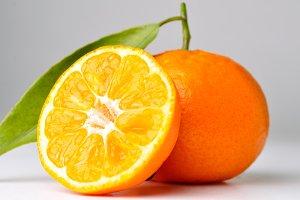 closeup of a mandarin on a grey background