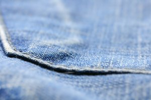 closeup of blue jeans pocket, shallow dof