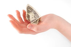 Woman hand holding crumpled cash