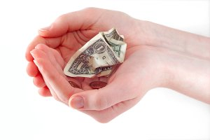 Woman hands holding crumpled cash