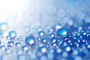 flying blue water drops