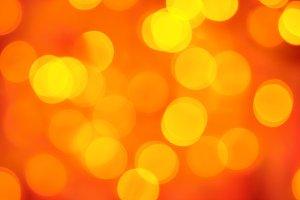 blurred golden lights on red background