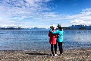 Mom and daughter enjoying the lake