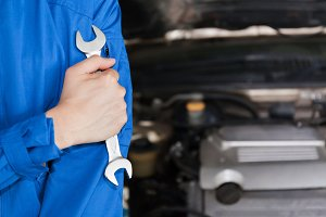 Man in blue technician uniform going to repair for car maintenance