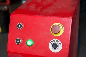 Emergency stop and safety release button in industrial factory