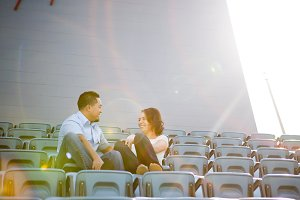 Engagement Couple in Baseball Stand