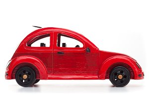 Red wooden toy car.