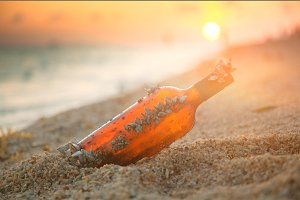 Message in a bottle on sunset